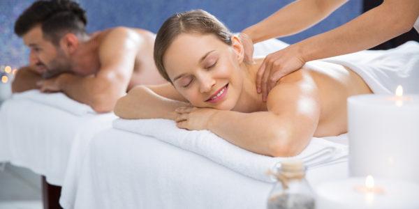 Happy Couple Having Spa Treatment in Salon